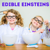 Edible Einsteins - two blonde haired girls wearing white lab coats and black glasses. They have an assortment of cooking utensils